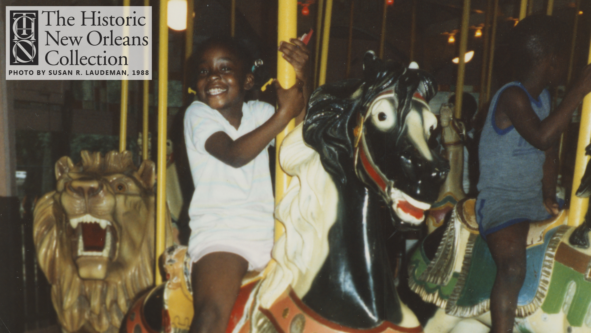 Child riding City Park Carousel