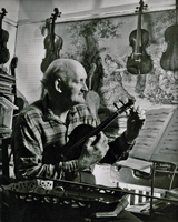 photo of William Russell tuning a violin