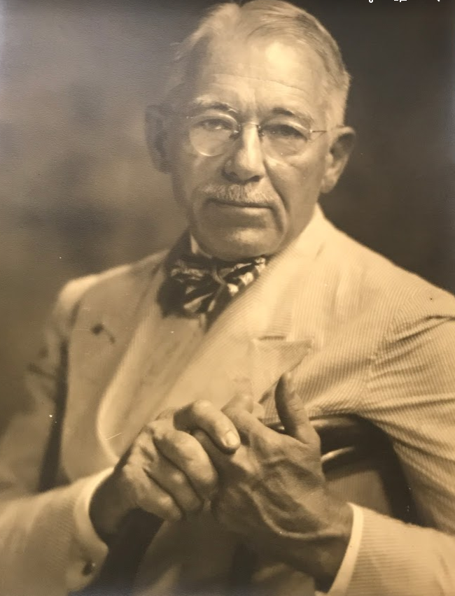 "An unidentified man sports a seersucker suit in this image by Joseph ""Pops"" Whitesell."