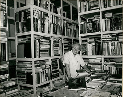 Clarence John Laughlin in his home library; 1981; photoprint mounted on board by Nancy Robinson Moss; The Historic New Orleans Collection, gift of Mr. Stanton M. Frazar, 1985.242