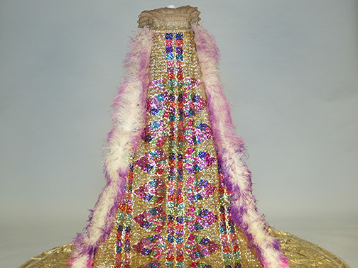 Costume worn by Mystic Club Queen Mrs. Reuben Tipton; created for Feb. 3, 1940; gold lamé, rhinestones, plastic, wire, feathers, and sequins; The Historic New Orleans Collection, gift of Mrs. Bruce R. Hoefer, 1997.78