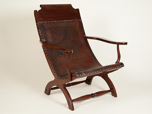 Campeche chair; ca. 1815; mahogany and leather: chair probably made in Louisiana, leather made in Mexico; The Historic New Orleans Collection, acquisition made possible by the Laussat Society, 2016.0108.1