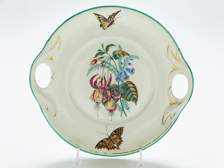 Cake plate; ca. 1876; hand-painted porcelain; by Mary Bella Brice; The Historic New Orleans Collection, gift of N. West Moss, 2017.0504.1.2