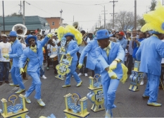 Members of the Cross the Canal Steppers are shown dancing with fans and baskets in this 2016 photograph by Charles M. Lovell.