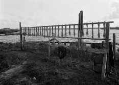 A 1974 image shows a net rack at a fishing camp in Fala, Louisiana. Fala was the site of an important Native American settlement, but by the end of the 1980s it had been completely overtaken by Gulf waters.