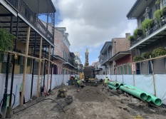 Construction crews replace an old water line on Bourbon Street.