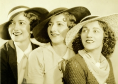 The Boswell Sisters are pictured wearing hats.